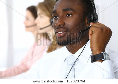 Call center operators. African american businessman in headset
