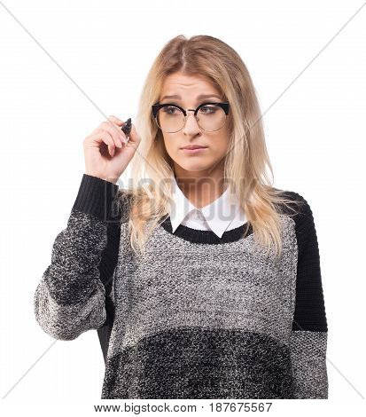 Upset young business woman drawing with marker isolated on white.