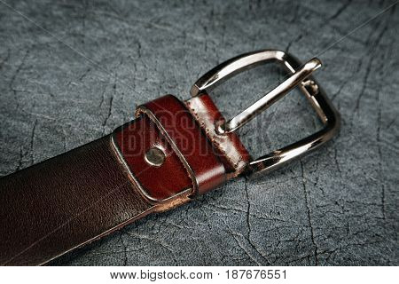 Female Belt Against From A  Leather Grey