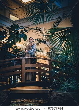 Romantic couple in the tropical jungle near the creek.