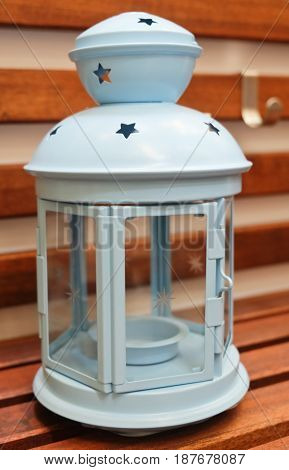 Decorative Light Blue Vintage Lantern on A Wooden Table Used to Illuminate Surrounding Space for Decorations and Atmosphere.