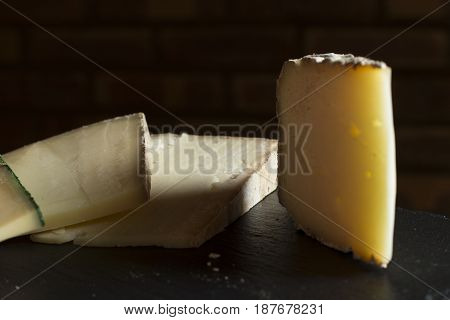 Cheese Assortment On Black Background. Various Sorts Of Cheese For Appetizing, Gourmet, Delicious Sn