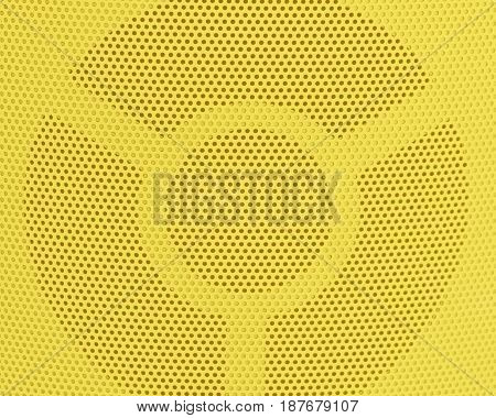 Background Pattern Horizontal Texture of Yellow Metallic Perforated Grid with Copy Space for Text Decorated.