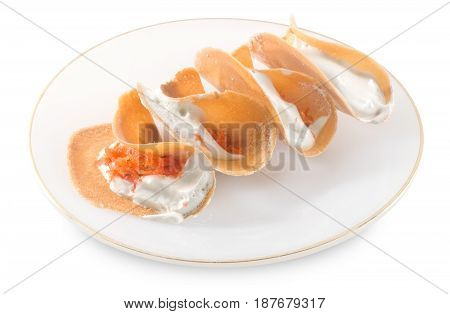 Thai Traditional Snack and Dessert Plate of Thai Crispy Pancake or Thai Crepes Filled with Sweet Coconut Cream and Salted Shredded Coconut Isolated on White Background.