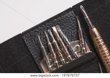Tool for repair electronic devices close up. Set of special instruments for modern gadgets maintenance.