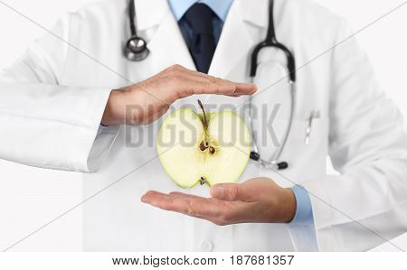 Healthy food and natural nutrition medical diet concept hands doctor with apple fruit