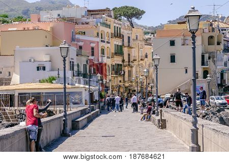 Iaschia March 2017, Italy: View of the seaside village of Ischia Ponte, tourists visiting the castle Aragonese already fortress, Prision and Monastery of the Ischia island, Bay of Naples Italy