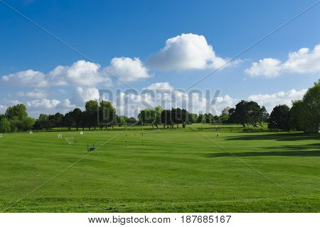 General View Of A Green Golf Course On A Bright Sunny Day. Idyllic Summer Landscape. Sport, Relax, R