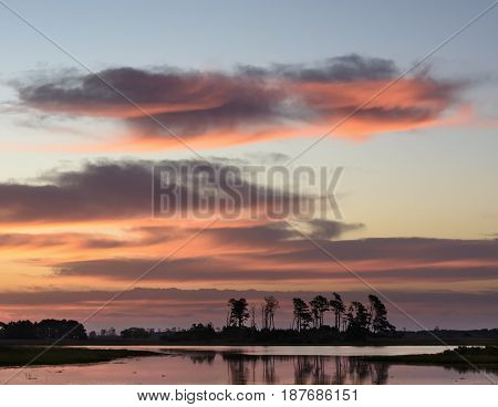 Colorful Sunrise with Clouds Above Salt Marsh