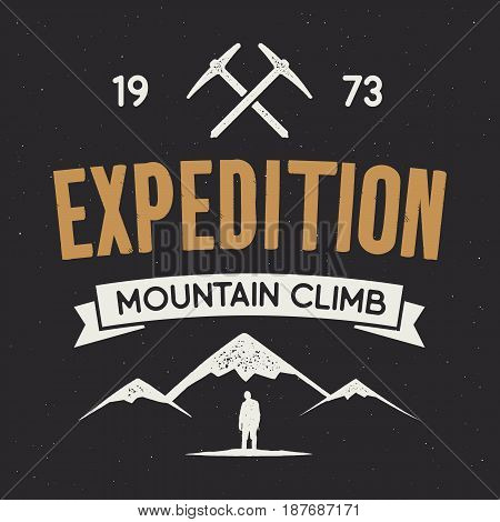 Mountain expedition label with climbing symbols and type design - mountain climb. Vintage letterpress style style. Outdoors adventure emblem for t-shirt clothing print. Vector isolated on dark