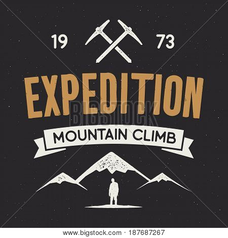 Mountain expedition label with climbing symbols and type design - mountain climb. Vintage letterpress style style. Outdoors adventure emblem for t-shirt clothing print. isolated on dark