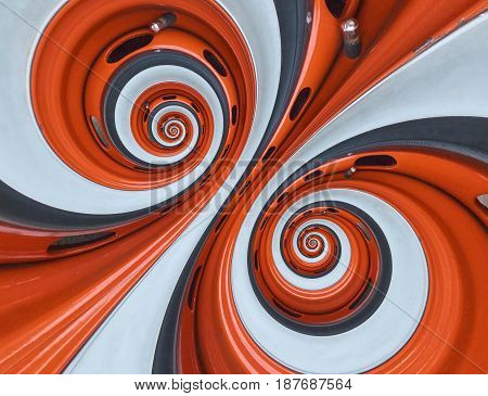 Car automobile wheel rim tire doubel spiral abstract fractal background. Orange wheel rim spiral effect pattern abstract background. Automotive abstract wheel. Incredible orange white car wheel rim