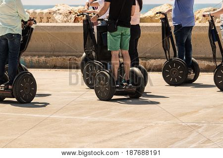 A group of people are riding on Segway