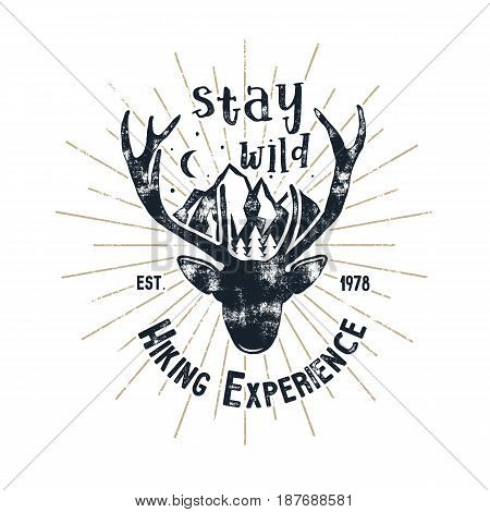 Hand drawn vintage camping badge and hiking label with hiking design elements and typography - stay wild. Vector design.