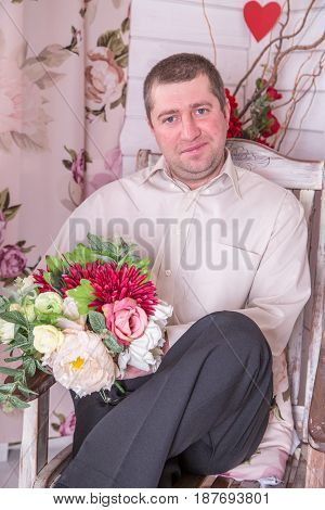 Young groom posing for the camera indoors