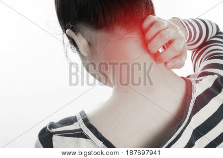 young woman scratching neck on isolated white background. concept of health care lifestyle. view from back body.