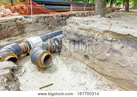View of unfinished diverting new pipeline in trench. poster