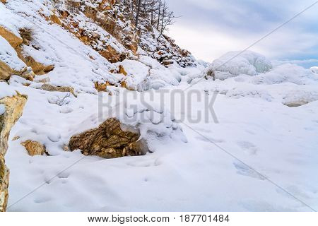 Rocks in Lake Baikal covered with ice and snow Russia