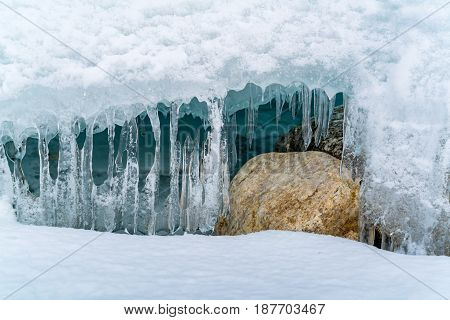 Icicles at ice cave in Frozen Lake Baikal in winter