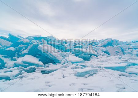 Ice blocks covered with snow in Lake Baikal in winter