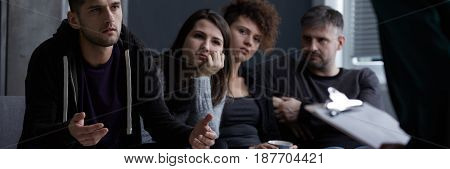 Serious Man Talking With Psychologist