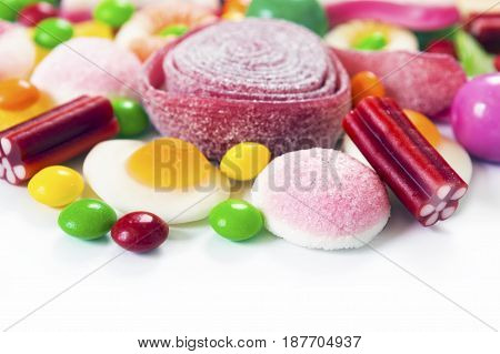 Colorful candies jelly and marmalade on white background with copy space
