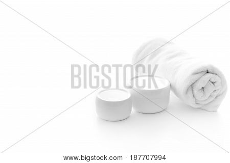 Different Skin Cream Or Body Lotion And Towel Isolated On White