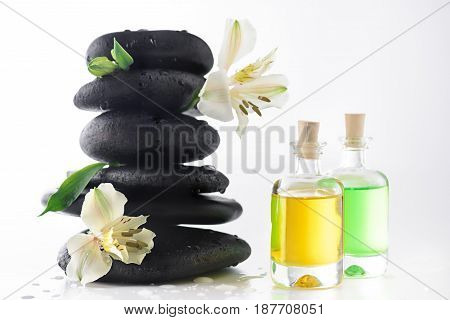 Zen Stones With Flowers And Essential Oils Isolated On White, Spa Treatment Concept
