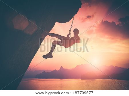 Climber Against Red Sunset. Instagram Stylisation