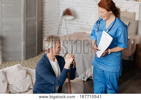 Ensuring comprehension. Kind qualified experienced therapist making sure elderly gentleman understanding everything about his treatment while giving him a little lecture