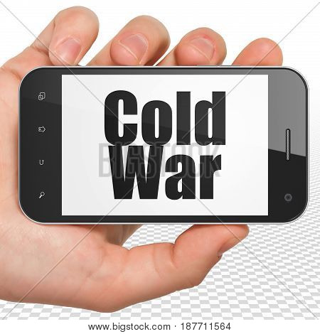 Political concept: Hand Holding Smartphone with black text Cold War on display, 3D rendering