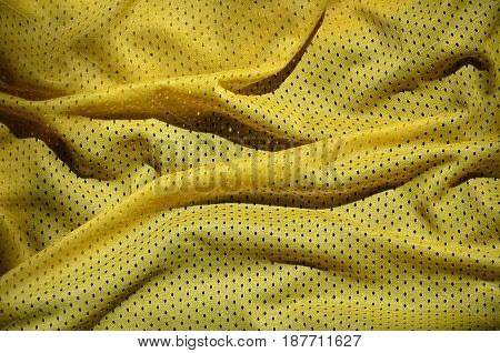Close Up Of Yellow Polyester Nylon Sportswear Shorts To Created A Textured Background
