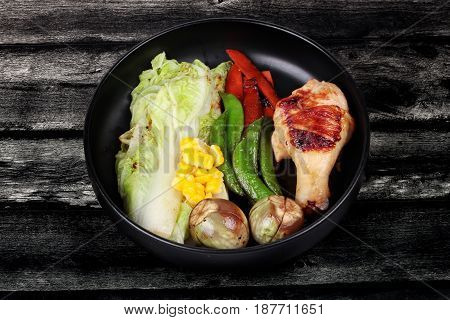 Chicken Drumstick Steak And Grilled Mixed Vegetables .