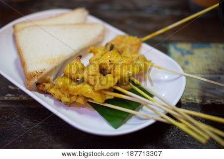Pork Satay. grilled pork served with bread Thai style food