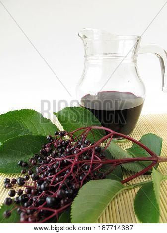 Elderberry juice and twigs of fresh elderberrys