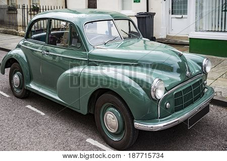 CORSHAM - UNITED KINGDOM - JULY 17: Vintage Classic Morris Minor in small village in south of England on July 17 2015 in Corsham UK