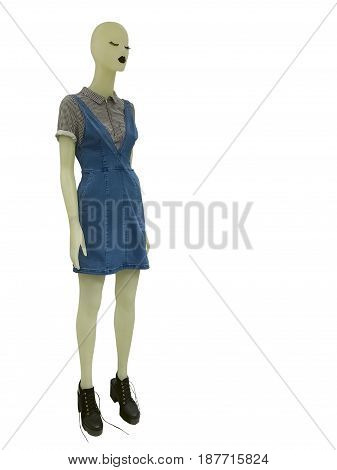 Full-length female mannequin dressed in jeans sundress isolated on white background. No brand names or copyright objects.