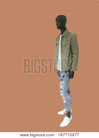 Full length male mannequin dressed in jacket and ripped jeans isolated. No brand names or copyright objects.