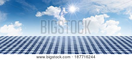 Blue checkered tablecloth with summer sky for a bavarian concept