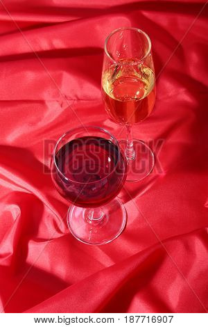 Two Glass of red, white wine on red background .