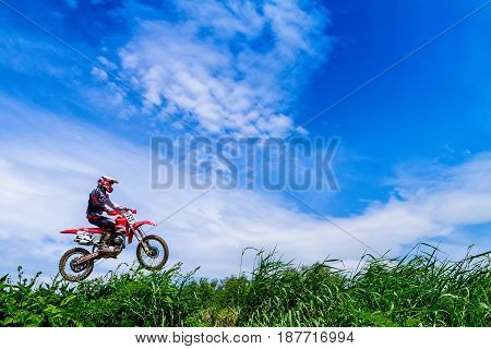 Uzhhorod Ukraine - May 21 2017: Unidentified rider in action against the sky at the Championship of Zakarpatie region on motocross on May 21 2017 in Uzhgorod Ukraine.