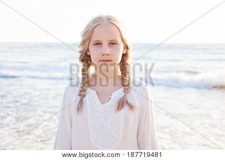 Happy Child Girl on the Beach. Innocence