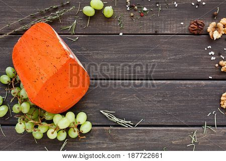 Cheese background. Gouda red pesto on rustic wood top view with copy space