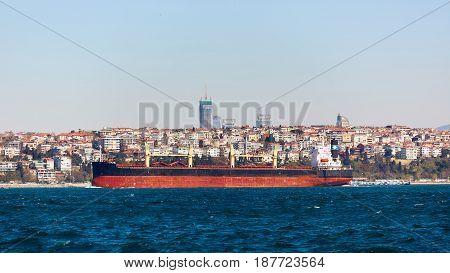 The tanker ship crosses the Bosporus on the background of Uskudar.