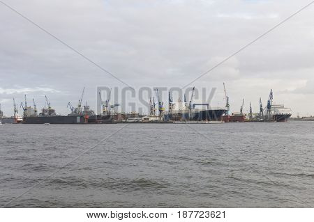 Transhipment cranes in Hamburg Sea Port. The Port of Hamburg is a sea port on the river Elbe in Hamburg Germany. It is Germany's largest port and second largest in Europe