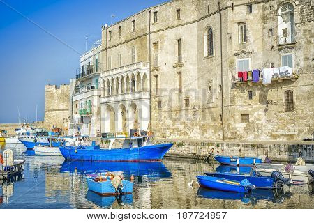 Blue Boats In Seaport Of Monopoli, Italy