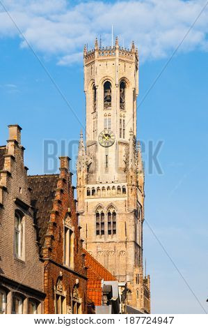 The Belfry Tower, aka Belfort, of Bruges, medieval bell tower in the historical centre of Bruges, Belgium. Close-up view of the top.