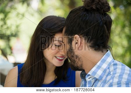 Close-up of romantic young couple spending leisure time in park