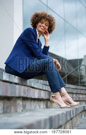 Smiling businesswoman sitting in the office premises