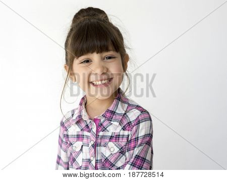 Little cute and adorable girl smiling studio portrait